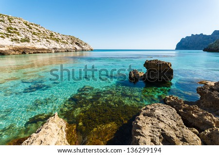 Turquoise sea water of Cala San Vicente beach, Majorca island, Spain