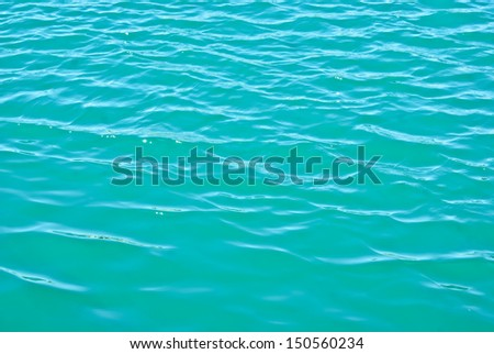 Turquoise sea water with ripples by Balos lagoon in Greece, view from above  - stock photo
