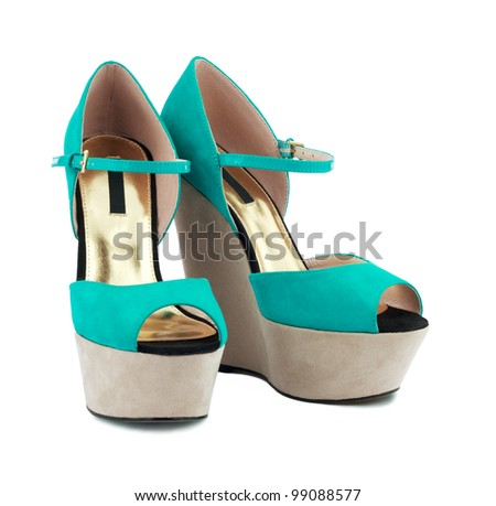 Turquoise shoes over white background