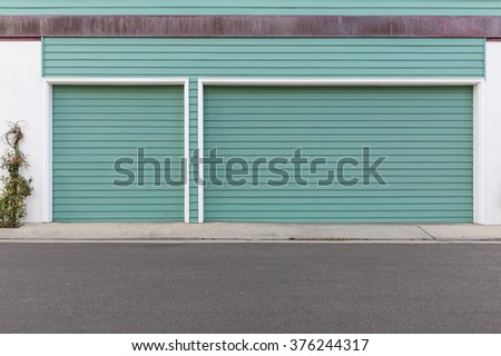 Turquoise three car garage door
