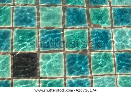 Turquoise tiles pool sun reflex - stock photo