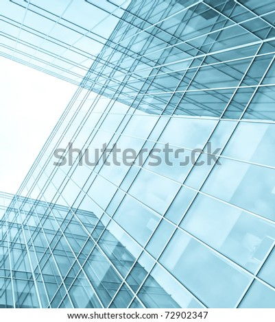 turquoise wall of glass building skyscrapers