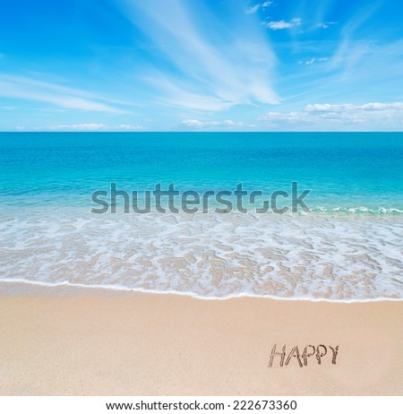 "turquoise water and golden sand in Sardinia with ""happy"" written in the sand on a cloudy day"