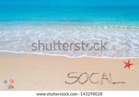 "turquoise water and golden sand with shells and sea stars and ""socal"" written on it - stock photo"