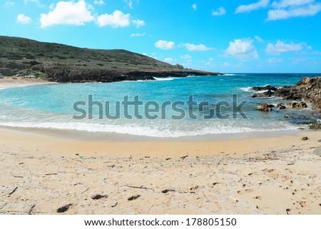 turquoise water in Argentiera beach, Sardinia - stock photo