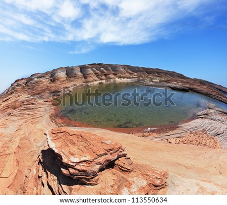 Turquoise water in the red desert. Flood of the artificial lake Powell photographed Fisheye lens - stock photo