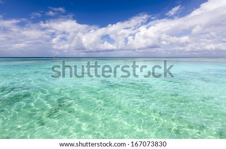 Turquoise water of a warm lagoon of the tropical island. - stock photo