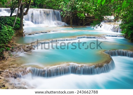 Turquoise water of Kuang Si waterfall, Luang Prabang. Laos - stock photo