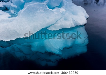 Turquoise water with huge ice formations - stock photo