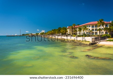 Turquoise waters of the Gulf of Mexico and buildings along the beach in Key West, Florida. - stock photo