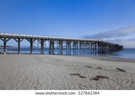 Turquoise waves break California coast - stock photo