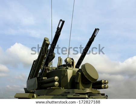 Turret of a combined short to medium range  missile and anti-aircraft artillery vehicle. - stock photo