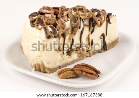 Turtle cheesecake slice - stock photo