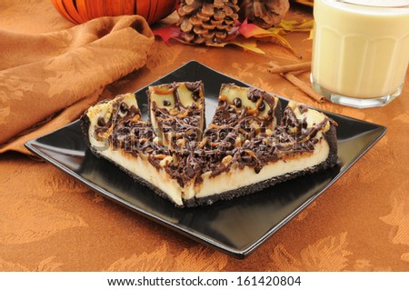 Turtle cheesecake with chocolate, caramel, walnuts and eggnog on a holiday table - stock photo