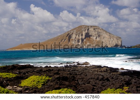Turtle Island, Oahu viewed from Makapuu Beach - stock photo