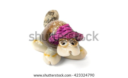 turtle of sea shells in a hat on a white background - stock photo