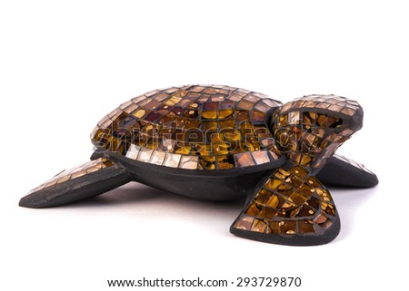Turtle wood figurine isolated on white - stock photo