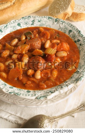 Tuscan bean soup made with cannellini beans courgette and Italian sausage - stock photo