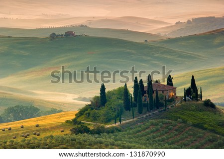 Tuscan countryside, italian landscape in early morning - stock photo