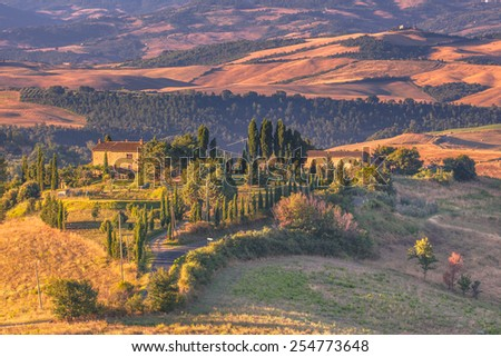 Tuscan Farms in the Early Morning Countryside - stock photo