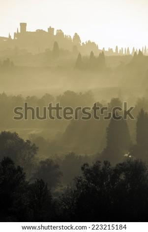 Tuscan landscape at dawn, Italy - sepia tone image - stock photo