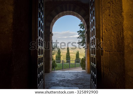 Tuscan view through the arch entrance - stock photo
