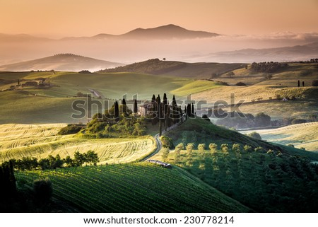 Tuscany, farmhouse in the country, blue sky, green grass, italian landscape - stock photo