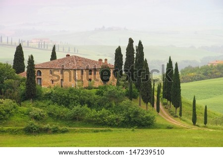 Tuscany house in fog  - stock photo