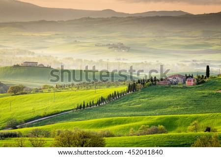 TUSCANY, ITALY - APRIL 12, 2016: Beautiful Tuscan countryside near San Quirico d Orcia, Tuscany, Italy - stock photo