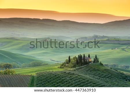 TUSCANY, ITALY - APRIL 16, 2016: Magical sunrise near San Quirico d Orcia, Tuscany, Italy - stock photo
