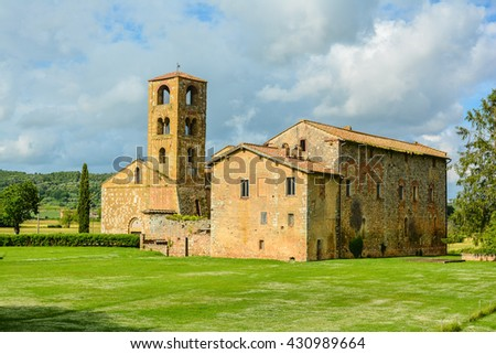 TUSCANY, ITALY - JUNE 01, 2016 -  church of San Giovanni Battista is a sacred Romanesque-style building is located in Ponte allo Spino, in the municipality of Sovicille, in the province of Siena