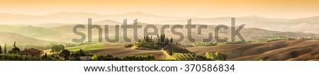 Tuscany, Italy landscape. Super high quality panorama taken at wonderful sunrise. Vineyards, hills, farm house. - stock photo