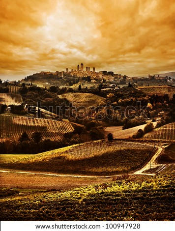Tuscany landscape, dramatic Sunset with San Gimignano in the background - stock photo