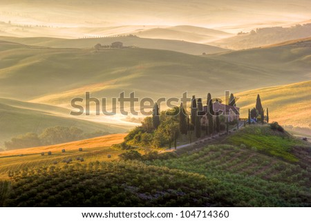 Tuscany landscape in early morning, Italy. Warm colors - stock photo