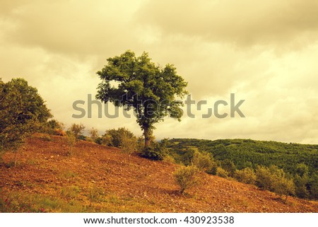 Tuscany landscape in rainy weather with dramatic cloudy sky. Val d'Orcia, Italy - stock photo