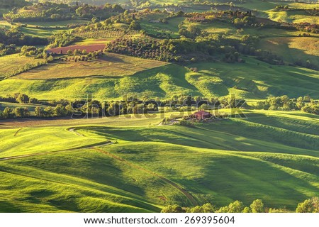 tuscany landscape on evening lighting view from montepulcciano - stock photo