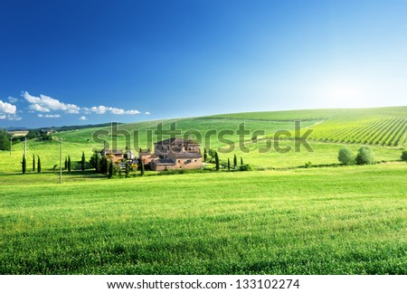 Tuscany landscape with typical farm house, Italy - stock photo