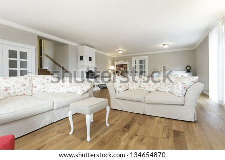 Tuscany - Living room with comfortable white sofa - stock photo