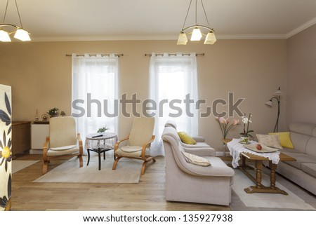 Tuscany - living room with couch and armchairs - stock photo