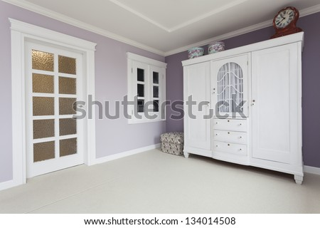 Tuscany - white furniture in bedroom - stock photo