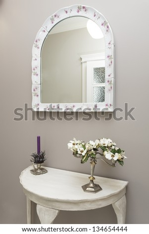 Tuscany - white table and mirror in hall - stock photo