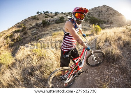 TUSCON, USA - DEC 4, 2011: downhill rider Simon Seeholzer at training on the trail in Tuscon, USA. There are yearly around 1000 bicycle related deaths in the US, 75 % due to head injuries.
