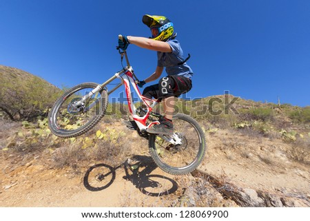 TUSCON, USA - JUNE 11: downhill bike rider in TUSCON, USA on June 11, 2012.  There are around 1,000 bicycle related deaths in the United States each year, 75% of which are due to head injuries.