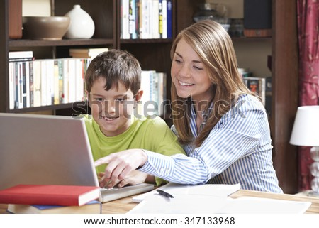 Tutor Helping Boy Studying At Home - stock photo