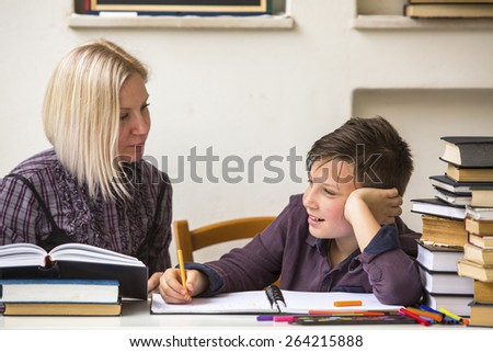 Tutor teaches a young student with his studies. - stock photo