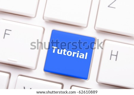 tutorial or e learning concept with key on computer keyboard