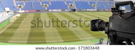 TV at the soccer.  video camera back football goal  - stock photo