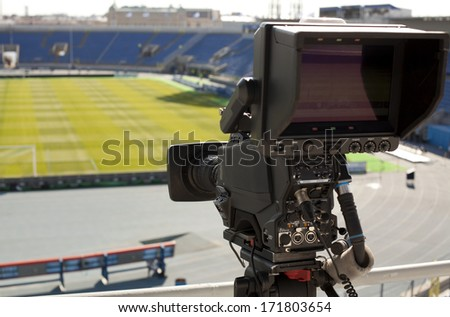 TV at the soccer.  video camera back football goal  - stock photo