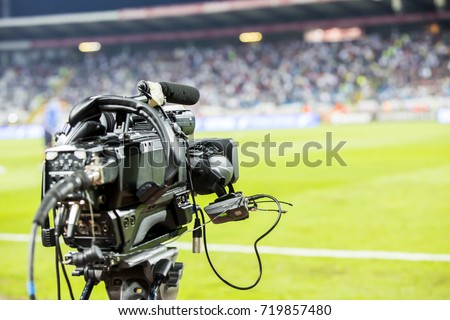 TV camera at the stadium during football matches