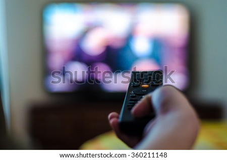 tv control in the hand - stock photo